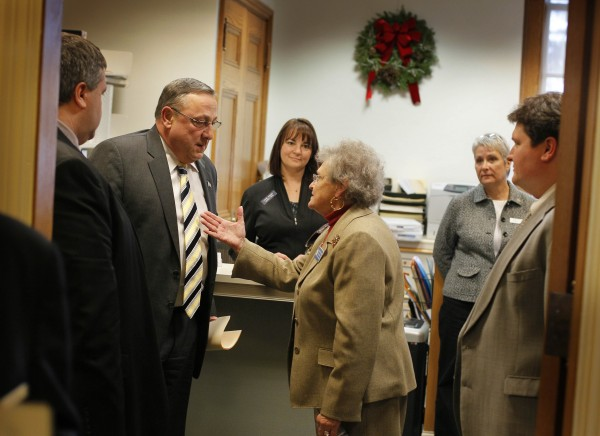 Gov. Paul LePage, left, listens to State Rep. Paulette G. Beaudoin, D-Biddeford, on a visit to the the House Speaker's office on his first day on the job, Thursdayat the State House in Augusta, Maine.