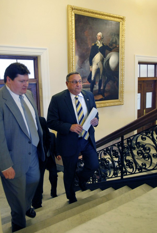 Gov. Paul LePage, right, passes a portrait of George Washington, as he heads to the House chamber, Thursday, Jan. 6, 2011, at the State House in Augusta, Maine.  In one of his first officials acts, LePage rescinded an order issued by his Democratic predecessor that barred state officials from asking people with whom they come into contact about their immigration status.