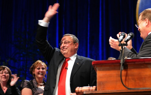 Gov. Paul Lepage waves to the crowd after being sworn in as Maine's governor on Wednesday during his inaugural at the Augusta Civic Center.