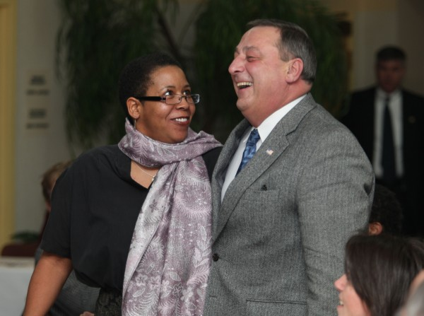 Gov. Paul LePage dances briefly with the Rev. Effie McClain, Monday at  the Waterville Rotary Club's annual Dr. Martin Luther King, Jr. Community Breakfast in Waterville, Maine.