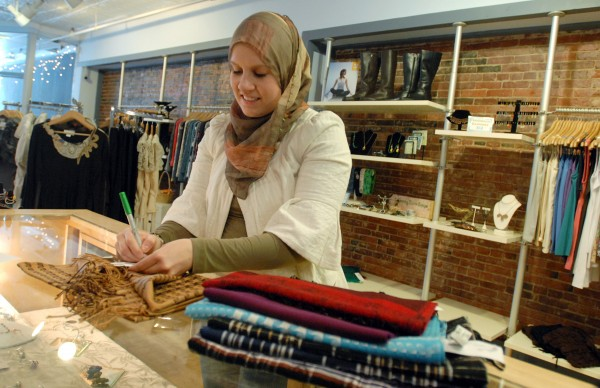 Heather van Frankenhuyzen prices inventory at Bella Luna on Main Street in downtown Bangor Thursday January 27, 2011.  Heather is a small business owner that uses social media outlets such as Facebook to connect with her customers and their friends.