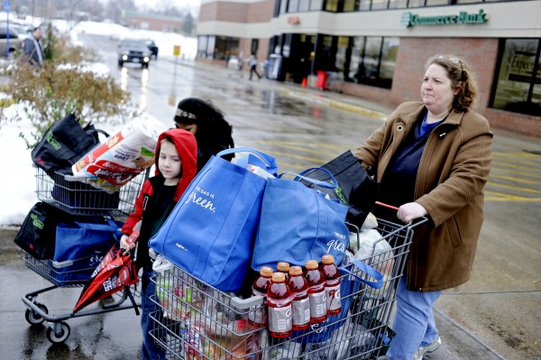 Tina Stever and her children stocked up on groceries Monday, Jan. 31, 2011, at Hy-Vee in Columbia, Mo., in preparation for a winter storm that was expected to dump 14 to 16 inches of snow on the area.