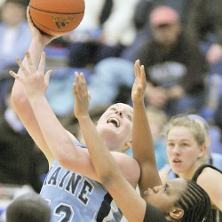 Maine's Jaymie Druding attempts to put up a shot over Binghamton's Kara Elofson in the first half of their game in Orono Saturday, Jan. 15, 2011.