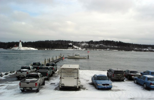 Vehicles belonging to the Maine Marine Patrol and the State Police Dive Team vehicles fill a parking area at Lubec on Jan. 20, 2011, during training exercises that identified the resting place of a sunken fishing vessel, the Miss Priss, in Cobscook Bay.&quotThis clearly shows the intense efforts the state has put into trying to understand the losses in Cobscook. All these people really care,&quot Capt. Robert Peacock said Tuesday. Seven fishermen and others were lost at sea between March 2009 and the winter of 2010.  &quotThe excellent underwater camera system that was used was loaned by Ramsdell Construction of Cutler and worked extremely well.&quot The Miss Priss, which was located in a treacherous area of the bay at Reversing Falls in Pembroke, sank a year ago and all three crewmen were rescued.