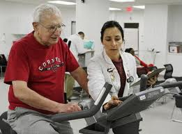 A heart patient participates in monitored exercise during a cardiac rehab session at the Cleveland Clinic.