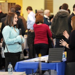 Laura Schnaible (right), staff recruiter for The New England Center for Children in Boston, talks with a UMaine student who declined to be identified on Wednesday during UMaine's Career Fair.