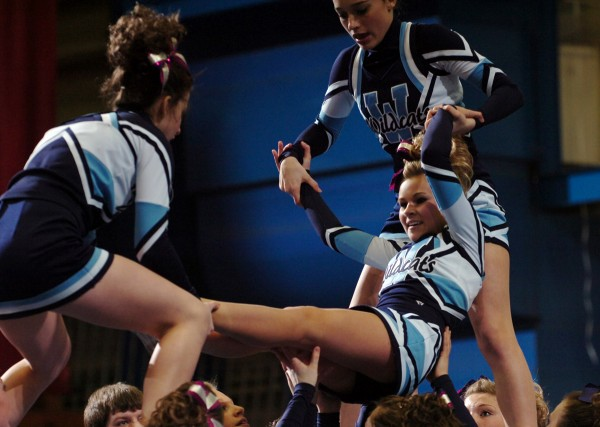 Members of the Presque Isle cheerleading team perform their routine at the Bangor Auditorium on Saturday, January 29, 2011 during the Eastern Maine Class B Regional Cheerleading Competition. Presque Isle took third place.