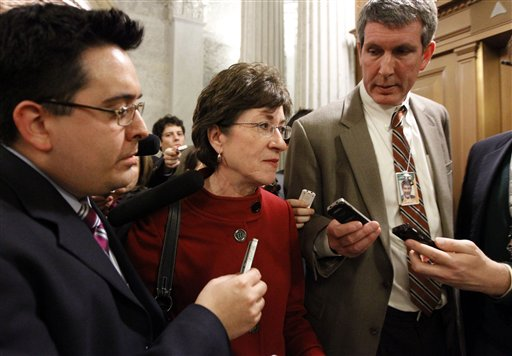 Sen. Susan Collins, R-Maine, second from left, talks with the media on Capitol Hill in Washington in December.