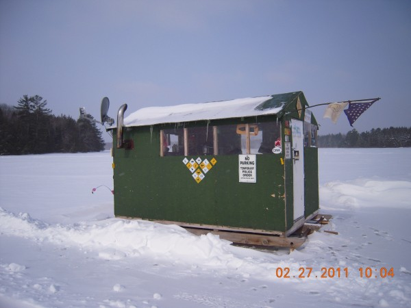 It is an ice shack built in two and put together on the ice. it has a chrome smokestack from an 18 wheeler I found in the ditch. It has HD satellite Tv solar and battery powered. At derby time all my friends and family come out and we cook anything from deep-fried ham and fries to turducken. It may not be pretty but it's well lived in.
