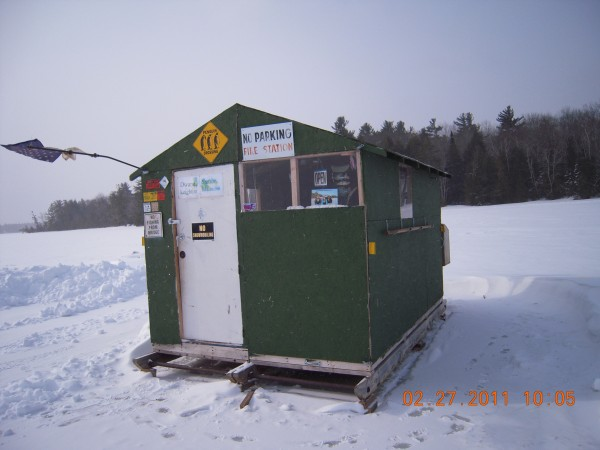 It is an iceshack built in two and put together on the ice. it has a chrome smokestack from an 18 wheeler I found in the ditch. It has HD satellite Tv solar and battery powered. At derby time all my friends and family come out and we cook anything from deep-fried ham and fries to turducken. It may not be pretty but it's well lived in.