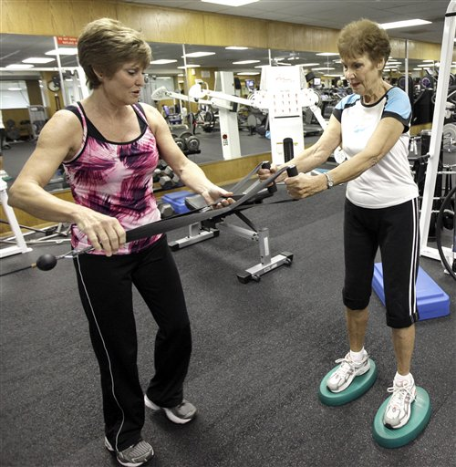 Julie Green, left, 58, helps her mother, Esther Robinson, right, 93, during a workout in Houston. Robinson wouldn't give up her life of fitness for anything. Active all her life, she still hits her local gym, but dancing is something she can enjoy with others.