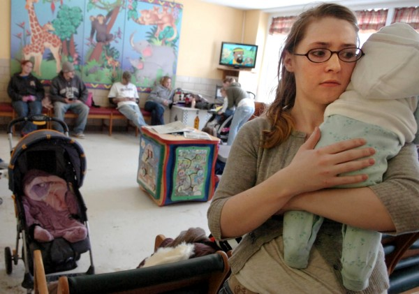 Francesca, who declined to give her last name, holds her 3-month-old daughter, Una, as they wait to meet with a social worker at Bangor's Health and Community Services office Wednesday. Francesca, a 24-year-old single mother of two, has been receiving general assistance, which is a temporary subsidy given by Maine municipalities to help cover housing, heat and basic living expenses for a short period of time. Francesca hasn't been able to secure employment and is thinking about going back to school to study psychology.