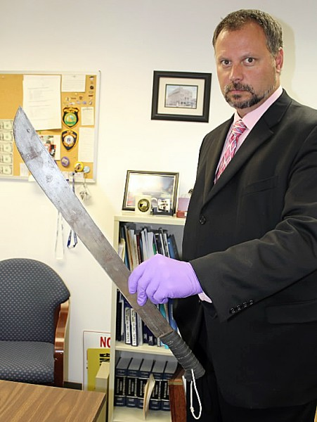 Rockland police Detective Russ Thompson displays in Sept. 2010 the 2-foot-long machete a man reportedly wielded as he tried to steal drugs from the Main Street Rite Aid, according to police.