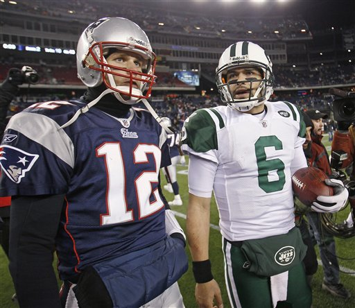 New England Patriots quarterback Tom Brady (12) and New York Jets quarterback Mark Sanchez (6) leave  the field after the Jets beat the Patriots 28-21 in an NFL divisional playoff football game in Foxborough, Mass., Sunday, Jan. 16, 2011.
