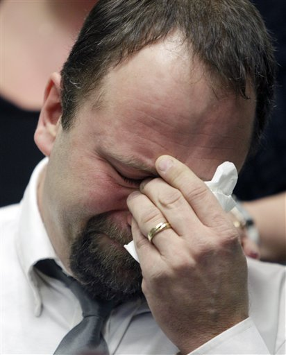 Mark Szpila, father of Melissa Barthelemy, weeps as he talks about her  during a news conference in Amherst, N.Y., Thursday, Jan. 27, 2011.