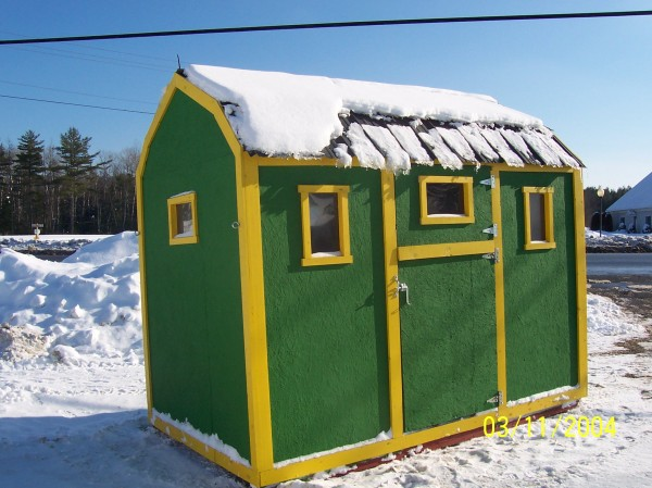The exterior of Jim Robertson's ice shack is painted in his favorite colors -- John Deere Green and yellow.