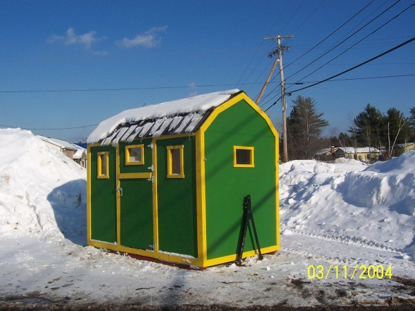 Jim Robertson of Lincoln has loved John Deere tractors all his life, so what other colors would there be when it came time to paiant the outside of his nearly complete ice shack.