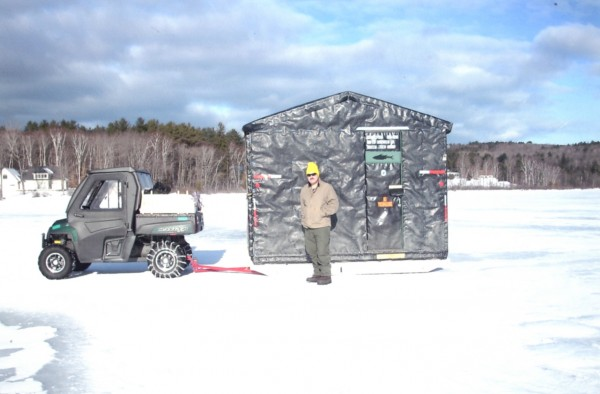 This past fall we decided to build ourselves an ice shanty. After a 20-year absence from ice fishing I wanted to introduce Wanda to what I once enjoyed about the sport. The ice shanty looks from the outside a lot like an old black tar paper shack found throughout Maine. The black in color, which is recycled industrial plastic, helps warm the building when the sun does shine and keeps things light at the same time. The inside's design and function is a different story completely. The structure is 6.5 feet by 12 feet long, more than 6.5 feet of head room, with white-painted walls and a loft area for storage of sleeping bags, pillows, blankets, and a tote that stores our queen-sized air mattress. The kitchenette area has a laminate counter top. An auto jump-starter provides 12-volt and and 110-volt power for the interior lighting. We use a propane shanty heater. Tiki torches at night light the area outside. A fold-up table under the window is perfect for serving &quotsuppa&quot or playing a game of cards or dice. We can move the shanty attached with long, wide skis with our Polaris Ranger. We winch it onto the trailer. The rear panel is removable. Everything inside folds up and away and we drive the 1,700-pound machine inside, strap it down, replace the rear panel or wall, raise the ramp and drive to another lake or home. Originality and practicality was our goal