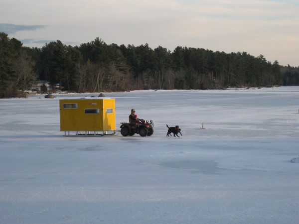 Hauling the Ice Condo out on the pond