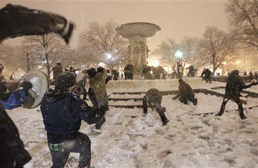 A snowball fight breaks out at Dupont Circle in Washington in the still-falling snow, Wednesday, Jan. 26, 2011.