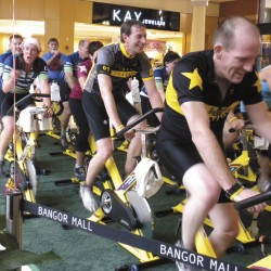 "Breast cancer survivor Jeff Bennett of Bangor (second row left), helped to organize a fundraiser Saturday at the Bangor Mall to benefit the Lance Armstrong Foundation. Bennett, who was diagnosed with cancer seven years ago, did three spin classes at center court and during a break said ""cancer doesn't have to control your life."" Several local celebrities, including WABI meteorologist Todd Simcox (back row left), participated."