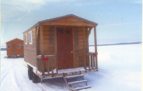 My ice shack is on wheels, is made with logs and has a little porch. it is roomy and makes a good home away from home.