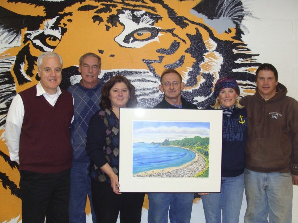 "Advisory board members for the Aine Taylor Knight Fund (from left) Bob Demont, Jack Taylor, Kelly Taylor, Eric Hopkins, Celia Knight and Sy Knight hold a print of ""Aine's Beach."" The original watercolor painting by Hopkins was raffled recently as a fundraiser for the fund. The winner was Jo Ann Connolly of South Portland. Prints and notecards featuring the image are still available for purchase to benefit the fund."