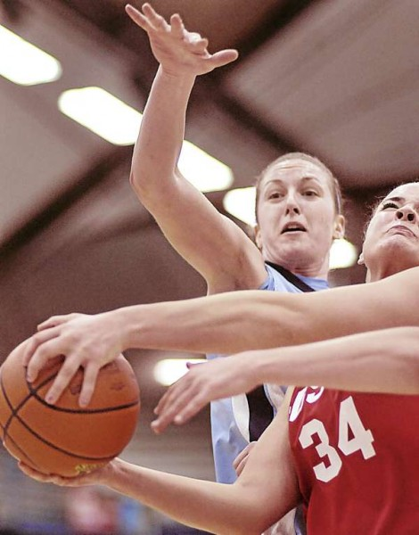 Maine's Samantha Baranowski focuses on the ball in the hands of BU's Caroline Stewart (34) for the block in the second half of their game in Orono Tuesday, Feb. 1, 2011.