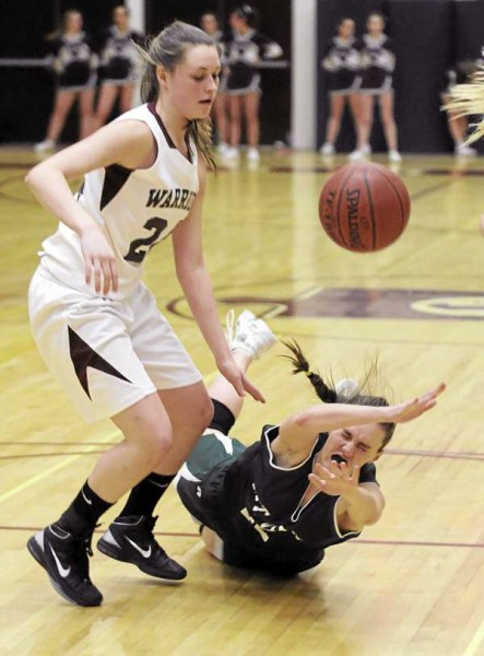 Mount View High School's Amanda Larrabee falls onto the floor after she collided with Nokomis High School's Brittany Dunton during the second half of the game in Newport Tuesday evening.  Nokomis won the game 60-23.