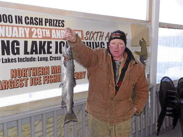 Pierre Chamberland of St. Agatha shows off the 5-pound, 7.2-ounce landlocked salmon he caught during the 6th annual Long Lake Ice Fishing Derby over the weekend. Chamberland won $1,500 for catching the largest salmon during the derby.