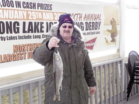 John Michaud of St. Agatha shows off the 2-pound, 1.8-ounce brook trout he caught to win that division during the 6th annual Long Lake Ice Fishing Derby over the weekend. Michaud took home a $1,250 prize for his efforts. (Photo courtesy of Paul Bernier)