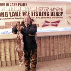 Linda Engelhardt of Fort Kent caught the largest lake trout, or togue, during the 6th annual Long Lake Ice Fishing Derby over the weekend. Engelhardt's fish weighed 14 pounds, 2.4 ounces and earned her a $1,500 prize.