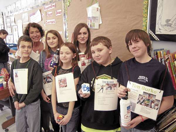 Seventh graders in Mrs. Marianne Dyer's social studies and English class at Presque Isle Middle School will greet World Cup biathletes on Feb. 4 wearing athletic &quotpinnies&quot they made with pictures of the athletes on the front and information about their home countries on the back. Class members with Mrs. Dyer include (from left) Quinn Thibeau, Kelsey Michaud, Eva Dunn, Karen Jones, Tony Robbins and Gannon Therrien.