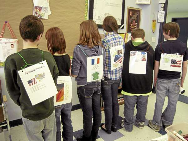 Seventh graders in Mrs. Marianne Dyer's social studies and English class at Presque Isle Middle School will greet World Cup biathletes on Feb. 4 wearing athletic &quotpinnies&quot they made with pictures of the athletes on the front and information about their home countries on the back. Class members include (from left) Quinn Thibeau, Eva Dunn, Kelsey Michaud, Karen Jones, Tony Robbins and Gannon Therrien.