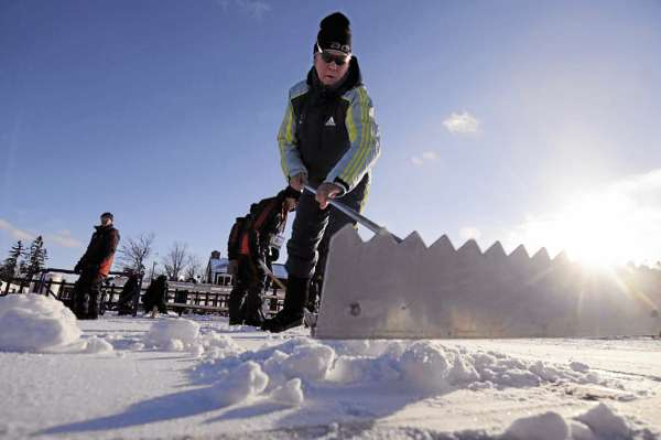A groomer levels some freshly added snow Thursday afternoon in the shooting area near the Nordic Heritage Center. The I.B.U. World Cup Biathlon competitions take place there Friday, Saturday and Sunday.