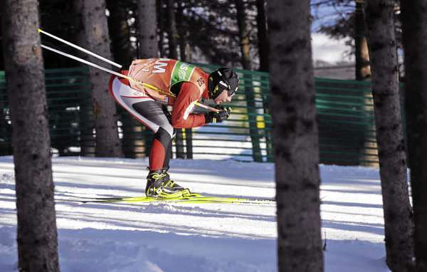 A member of the Austrian federation tests his skis while getting in some training Thursday afternoon, Feb. 3, 2011 near the Nordic Heritage Center. The I.B.U. World Cup Biathlon competitions take place there Friday, Saturday and Sunday.
