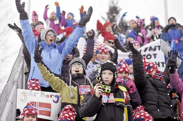 Jesse Hatcher, 10, of Presque Isle gets ready to take a picture as 106 other Zippel Elementary fifth graders as well as teachers and parents sing along to the Village People's song &quotYMCA&quot  just before the start of the men's 10 kilometer sprint competition at the I.B.U. World Cup Biathlon at the Nordic Heritage Center Friday morning, Feb. 4, 2011. World Cup biathlon action in Presque Isle continues Saturday and Sunday. The students recently incorporated the sport of biathlon into their curriculum and visited the venue Friday morning.
