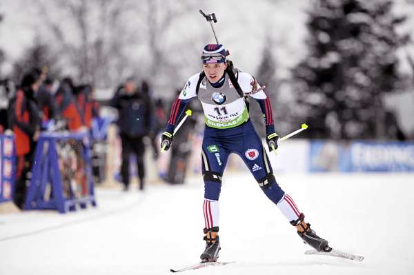 Sara Studabaker of the U.S crosses the finish to place 14th in the women's 7.5 kilometer sprint competition at the I.B.U. World Cup Biathlon at the Nordic Heritage Center Friday afternoon, Feb. 4, 2011. World Cup biathlon action in Presque Isle continues Saturday and Sunday.