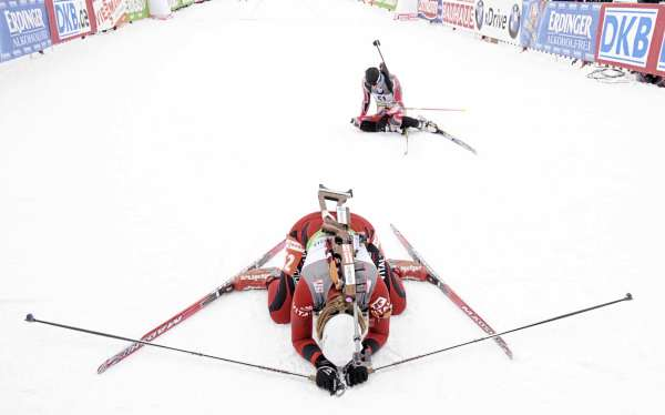 Fanny Welle-Strand Horn, foreground, of Norway and Rosanna Crawford of Canada collapsed after finishing the  women's 7.5 kilometer sprint competition at the I.U.U. World Cup Biathlon at the Nordic Heritage Center Friday afternoon, Feb. 4, 2011.