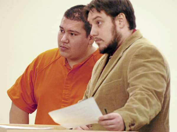 Albert J. Harnois III (left) of Greenbush makes his first appearance at the Penobscot Judicial Center in Bangor on Friday. Harnois was arrested Thursday after allegedly robbing the People's United Bank located inside the Mobil On the Run convenience store in Milford. At right is attorney Joseph Belisle.