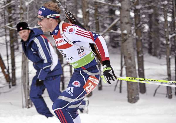 Lowell Bailey of the U.S. team gets encouragement from one of his coaches, Patrick Coffey, left, as they scale a hill during I.B.U. World Cup men's 12.5-kilometer pursuit at the Nordic Heritage Center in Presque Isle, Maine on Sunday, Feb. 6, 2011. Bailey was the first American to finish, placing 16th in Sunday's pursuit.