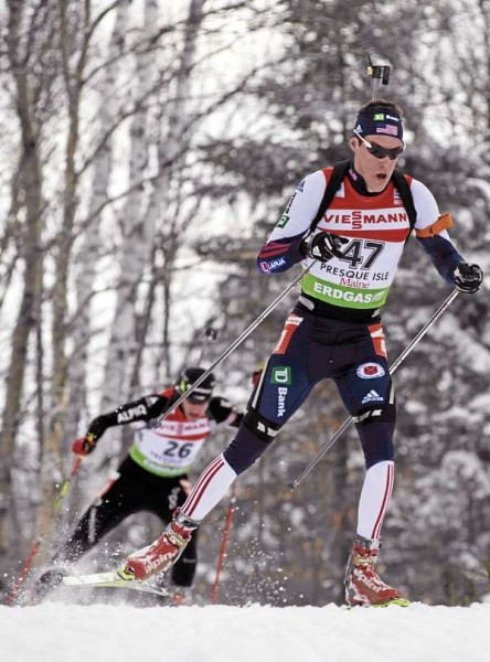 Leif Nordgren of the U.S.A crests a hill with Christian Stebler of Switzerland on his tail during the I.B.U. World Cup men's 12.5 kilometer pursuit at the Nordic Heritage Center in Presque Isle, Maine on Sunday, Feb. 6, 2011.