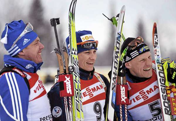 WInner Alexis Boeuf of France, center, poses for a group shot with Russia's Ivan Tcherezov, left (second place), and Sweden's Carl Johan Bergman (cq) (third place) following the I.B.U. World Cup men's 12.5 kilometer pursuit at the Nordic Heritage Center in Presque Isle, Maine on Sunday, Feb. 6, 2011.