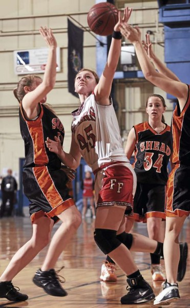 Fort Fairfield's Amanda Hotham (center) pulls in a rebound while surrounded by Shead defenders Halie Harris (left), Kirby McPhail (34) and Randi DeWitt during an Eastern Maine Class D quarterfinal in 2010 at the Bangor Auditorium. Hotham is leading Fort Fairfield back to the Auditorium where it hopes to defend its first-ever state title.