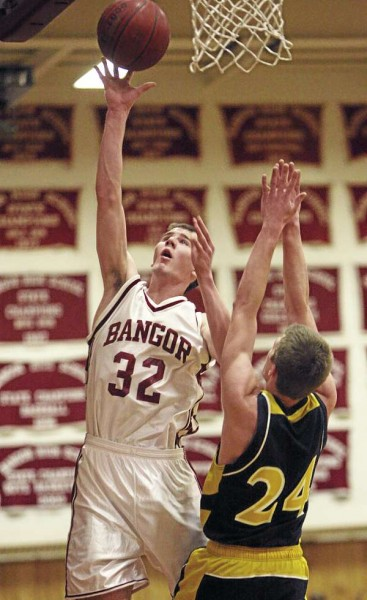 Bangor's Zach Blodgett goes up for a shot over Mt. Blue's Eric Berry during their game at Bangor High School on Tuesday, February 8, 2011. Bangor defeated Mt. Blue 63-47.