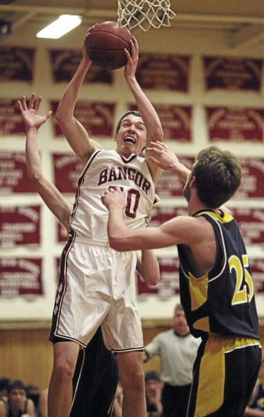 Bangor's Patrick Stewart goes up for a shot over Mt. Blue's Cam Sennick (foreground) and Nick Hilton during their game at Bangor High School on Tuesday, February 8, 2011. Bangor defeated Mt. Blue 63-47.