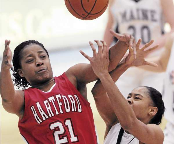 Hartford's Illicia Mathis and Maine's Corinne Wellington battle for control of the ball during first half action at Orono on Tuesday, February 8, 2011.