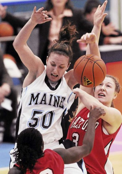 Maine's Samantha Baranowski gets stripped of the ball by Hartford's Daphne Elliot, bottom, and Taylor Clark, right, during first-half action at Orono on Tuesday, February 9, 2011.