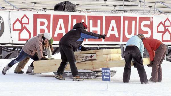 Volunteers move the podium in place as final preparations take place at the 10th Mountain Ski Center in Fort Kent Wednesday.  The venue will hoast the Biathlon World Cup event starting Thursday.