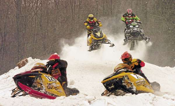 Competitors in the Pro 600-cc Class make their way around the course at the Lincoln Snowhounds Snowmobile Club's Sno-Cross Races in 2007.